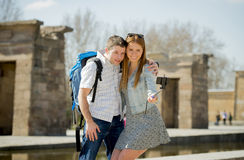 Young American student and tourist couple visiting Egyptian monument taking selfie photo with stick Stock Photo