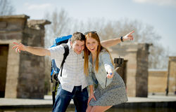 Young American student and tourist couple visiting Egyptian monument taking selfie photo with stick Stock Photos