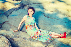 Young American Woman sitting rocks at Central Park, New York, re Stock Images