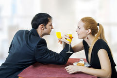 Young amorous couple celebrating at restaurant. Royalty Free Stock Image