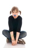 The young amusing girl with a dummy isolated Stock Photography