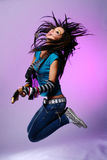 Young And Beautiful Girl Jump With Guitar Stock Image