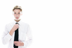 Young androgynous woman correcting her tie Royalty Free Stock Image