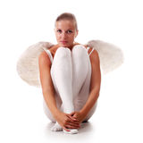 Young angel. Young beautiful naked woman with white wings Royalty Free Stock Image