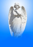 Young angel on a blue sky Royalty Free Stock Image