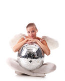 Young angel and disco ball. Young beautiful woman with white wings and disco ball Royalty Free Stock Photo