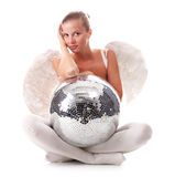 Young angel and disco ball. Young beautiful woman with white wings and disco ball Royalty Free Stock Image