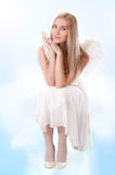 Young angel sitting on a cloud Royalty Free Stock Photography