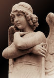 Young angel statue in sepia tones Royalty Free Stock Photography