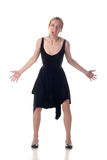 Young angered girl in a black dress. On a white background Royalty Free Stock Photos