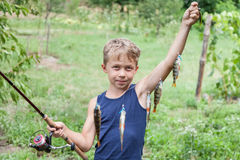 Young angler with tackle perch killer Royalty Free Stock Images