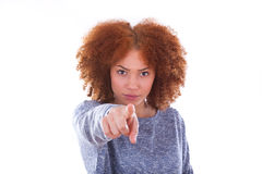 Young angry african american teenage girl pointing finger to the Royalty Free Stock Images