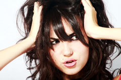Young angry beautiful woman. Screaming and pulling at her hair in anger royalty free stock photos