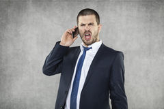 Young angry business man shouting. Young handsome angry business man Royalty Free Stock Image