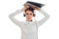 Young angry business woman in uniform with headphones and microphone looking at the camera and screaming isolated on. White Stock Photography