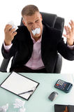 Young angry businessman with papers Royalty Free Stock Photo