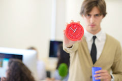 Young angry businessman pointing his watch as concept of arrive late at the work Stock Photography