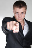 Young angry businessman pointing out his finger to Stock Image