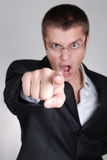 Young angry businessman pointing out his finger to Royalty Free Stock Photo
