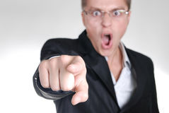 Young angry businessman pointing out his finger to Royalty Free Stock Photos