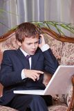 Young angry businessman talking on cell Royalty Free Stock Photo