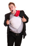 Young angry businessman tearing his shirt. In frustration isolated on white Royalty Free Stock Photography