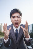 Young Angry Businessman Yelling Stock Images