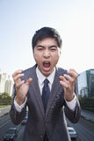 Young Angry Businessman Yelling Royalty Free Stock Photo