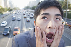 Young Angry Businessman Yelling Over Freeway Stock Photography