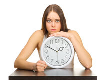 Young angry girl with clocks Stock Photos