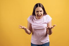 Young angry girl screams. Rebellious age concept. stock photo