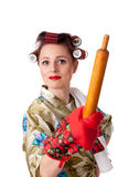 Young angry housewife with roller for dough. Stock Photo