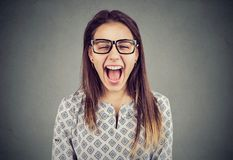 Young angry hysterical woman screaming in frustrtaion stock photo