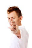 Young angry man doing a gun gesture Stock Photography