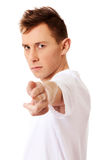 Young angry man doing a gun gesture Royalty Free Stock Images