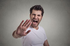 Young angry man screaming to stop stay away Royalty Free Stock Photos