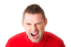 Young angry man screaming Stock Images