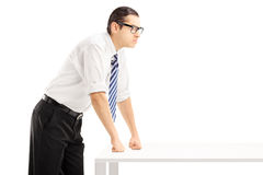 Young angry man on a table Royalty Free Stock Photos