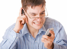 Young angry man talking on the phone Royalty Free Stock Photography