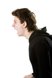Young angry man yelling Isolated on the white Stock Photo