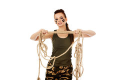 Young angry soldier woman tugging a rope.  royalty free stock photography