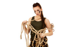 Young angry soldier woman tugging a rope.  Royalty Free Stock Photos