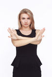 Young angry woman in black dress Stock Photography