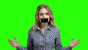 Young angry woman with black tape on her mouth. stock video