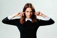Young angry woman closing her ears Royalty Free Stock Images