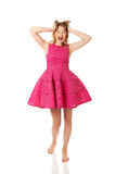 Young angry woman with pink skirt Stock Photography