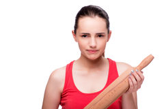 The young angry woman with rolling pin isolated on white Stock Photo