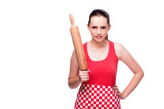 The young angry woman with rolling pin isolated on white. Young angry woman with rolling pin isolated on white Stock Photo