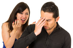 Young angry woman screaming at boyfriend husband. Young angry women screaming at boyfriend husband isolated on white Royalty Free Stock Photos
