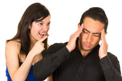 Young angry woman screaming at boyfriend husband. Young angry women screaming at boyfriend husband isolated on white Royalty Free Stock Image